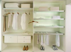 A Lighted Closet Reorganized by Chaos Commandos with Shelving and Draws. Click to Enlarge.