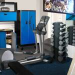 We set up an elliptical trainer and a full set of free weights with plenty of space to move. Steel cabinetry was installed for storage. We painted all cabinets blue and installed mirrors on the walls to check form.  Then we put in a TV to enjoy while working out. Contact Chaos Commandos today!